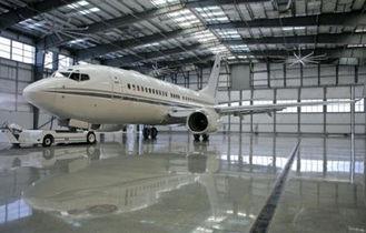 China Elektrischer galvanisierter, malender Metallwasserdichter Flugzeug-Hangar von friedlichen Binder-Gebäuden fournisseur