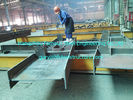 China Pre Engineering Commercial Steel Buildings H Section Beam Coated Grey Painting factory